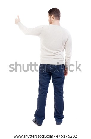 Back view of business man shows thumbs up bearded man in a white warm sweater showing thumb up.