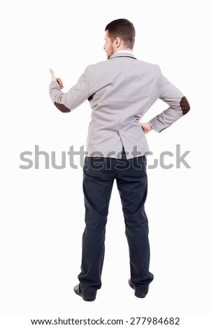 Back view of  business man shows thumbs up.   Rear view people collection. cheerful office worker shows positive emotions.  backside view of person. bearded man showing a sign of success. - stock photo