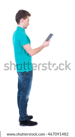 back view of business man uses mobile phone.    rear view people collection. Isolated over white background. backside view of person. Curly man in a turquoise sweater standing sideways and looking at