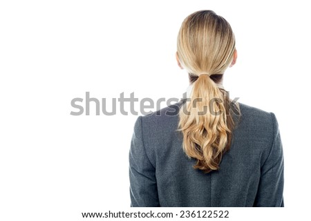 Back view of business woman, facing the wall.  - stock photo