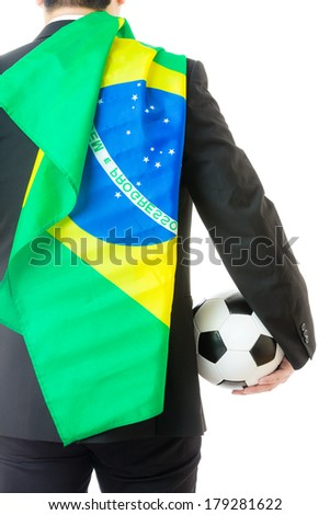 Back view of businessman holding soccer ball and Brazil flag - stock photo