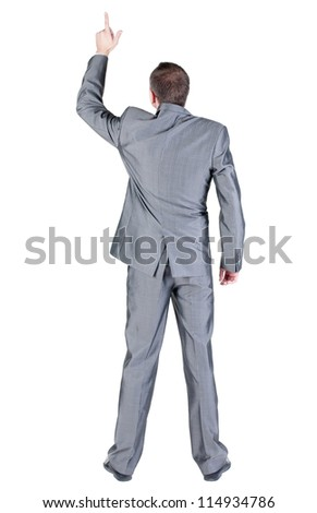 Back view of businessman pointing at wall. Rear view people collection.  backside view of person.  Isolated over white background. - stock photo