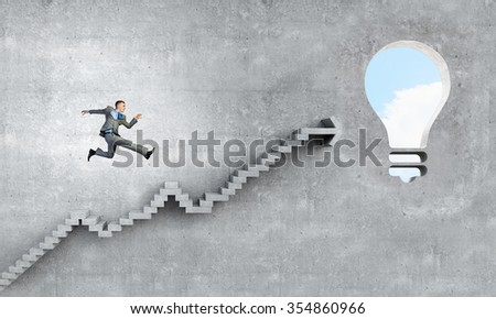 Back view of businessman standing on ladder and big idea bulb - stock photo