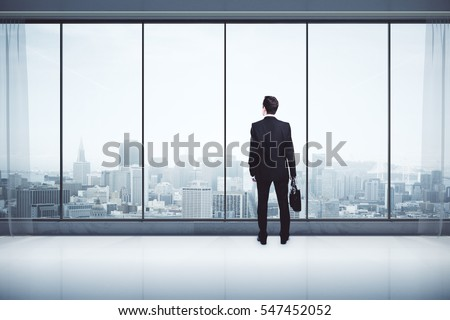 Back view of businessman with briefcase in modern interior with city view, looking into the distance. Research concept. 3D Rendering