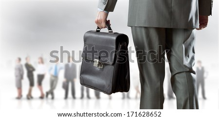 Back view of businessman with business team at background - stock photo