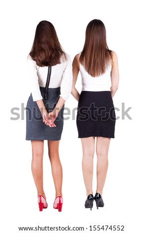back view of businessteam. two young  business woman Rear view people collection.  backside view of person.  Isolated over white background.