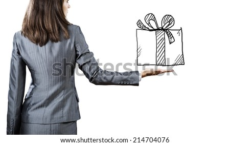 Back view of businesswoman holding present box in hand - stock photo