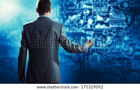 Back view of confident businessman drawing business sketches - stock photo