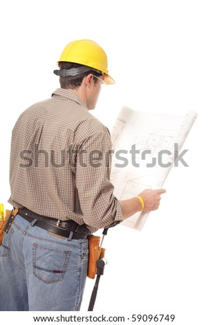 Back view of construction worker reading blueprints isolated on white