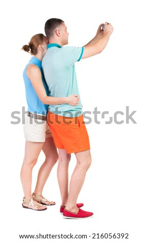 Back view of couple photographing. Tourists take pictures of the family together. Rear view people collection.  backside view of person. Isolated over white background. - stock photo