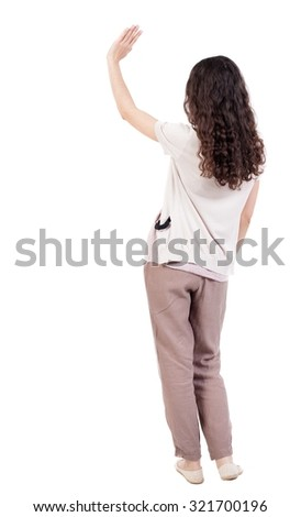 Back view of curly woman welcomes. Young teenager girl hand waving from. Rear view  people collection.  backside view of person.  Isolated over white background. Curly girl waving good-bye. - stock photo