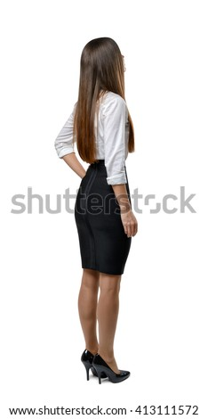Back view of cut out businesswoman holding her hand on waist.  Business staff. Office clothes. Dress code. Presentable appearance. Beauty and youth. - stock photo