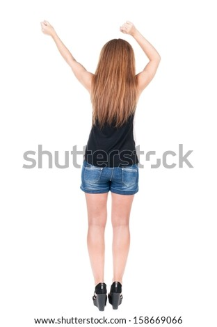 back view of dancing young beautiful  redhead woman. girl  watching. Rear view people collection.  backside view of person.  Isolated over white background.  - stock photo