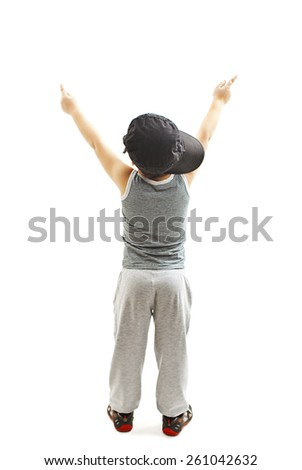Back view of fashionable little boy.Hip-Hop Style  points at wall. Pose Boy in Tracker Hat. Young Rapper. Funny Child in Cap. 5 years old. Rear view. Isolated on white background   - stock photo