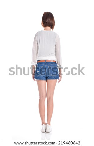 Back view of full body woman. beautiful girl in shorts. - stock photo