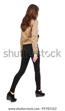 back view of going girl. woman in motion. Rear view people. Isolated over white background. - stock photo