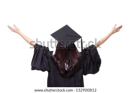 back view of graduate student girl hug future and look up to copy space, she wear graduation cap and gown ,asian woman - stock photo