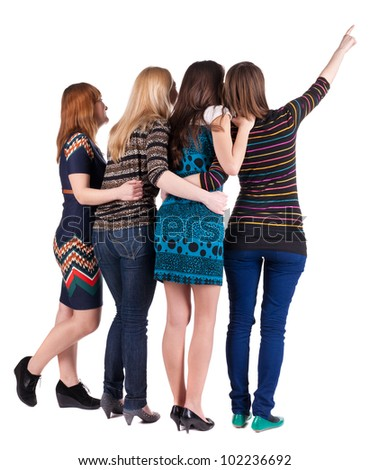 Back view of group beautiful women pointing at wall. Girls team. Girl friends looks into the distance. Rear view people collection.  backside view of person. Isolated over white background - stock photo