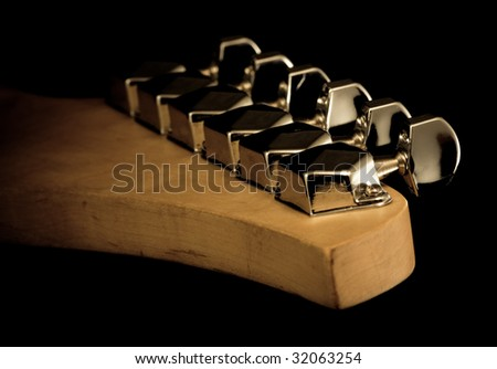 back view of guitar head isolated on black - stock photo