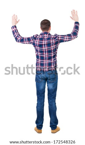 Back view of handsome man in checkered shirt  lwaving from his hands. Standing young guy in jeans. Rear view people collection.  backside view of person.  Isolated over white background. - stock photo