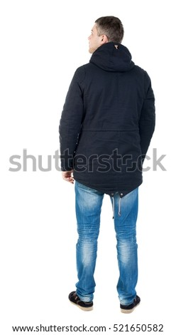 Back view of handsome man in winter jacket  looking up.   Standing young guy in parka. Rear view people collection.   Isolated over white background. man in jacket looking to the right