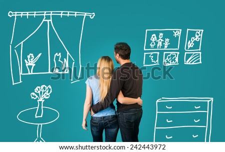 Back view Of Happy Couple Dreaming Of Their New Home And Furnishing On Blue Background. - stock photo