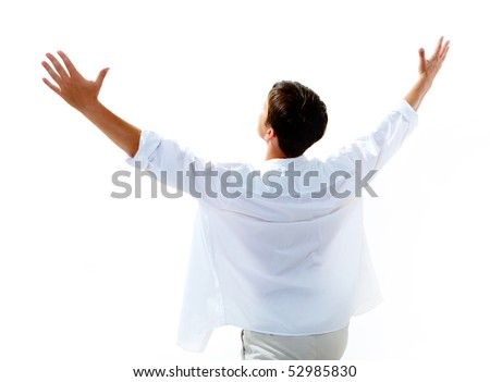 Back view of happy young man raising his arms enjoying life - stock photo