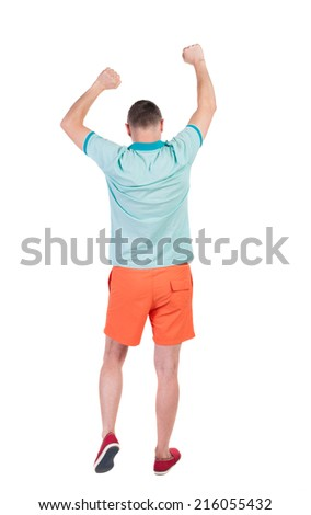 Back view of  joyful man celebrating victory hands up. Rear view people collection. backside view of person. Isolated over white background.