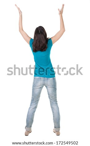 Back view of joyful woman celebrating victory hands up. Rear view people collection. backside view person. Isolated over white background. slender brunette in jeans shows symbol success or hitchhiking - stock photo
