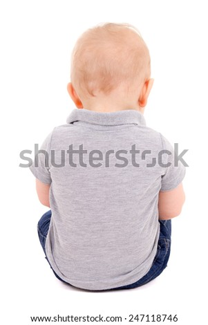 back view of little baby boy sitting isolated on white background - stock photo