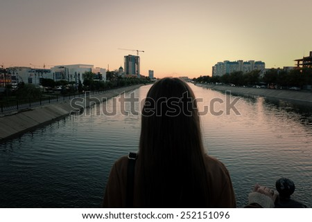 Back view of lonely women at sunset - stock photo