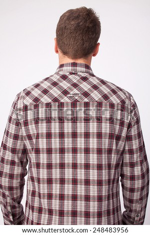 Back view of male wearing casual shirt - stock photo