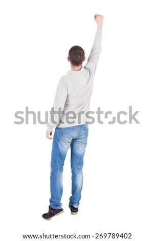 Back view of  man in checkered shirt Raised his fist up in victory sign.   Rear view people collection.  backside view of person.  Isolated over white background. - stock photo