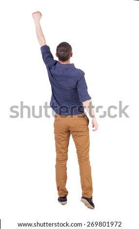 Back view of  man in checkered shirt Raised his fist up in victory sign.   Rear view people collection.  backside view of person.  Isolated over white background.