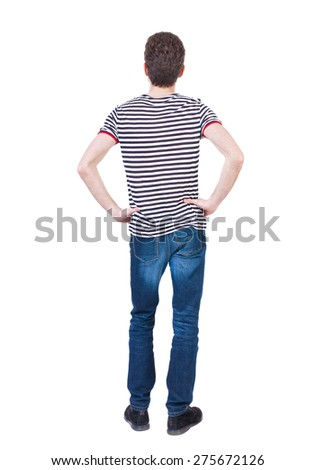 Back view of man in jeans. Standing young guy. Rear view people collection.  backside view of person.  Isolated over white background. The guy in the striped shirt with hands on hips standing. - stock photo