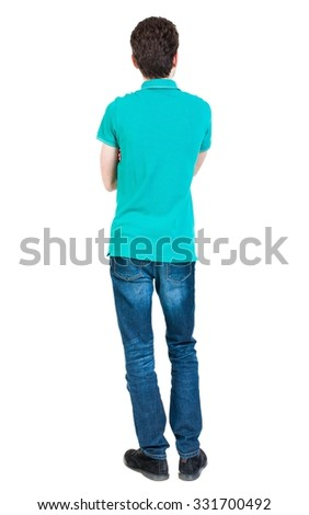 Back view of man in jeans. Standing young guy. Rear view people collection.  backside view of person.  Isolated over white background. A guy in a T-shirt is stylish aquamarine arms folded. - stock photo