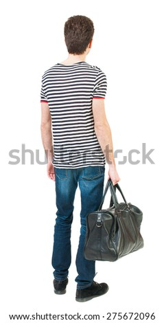 Back view of man in jeans with bag in his hand. Standing young guy. Rear view people collection.  backside view of person.  Isolated over white background. - stock photo