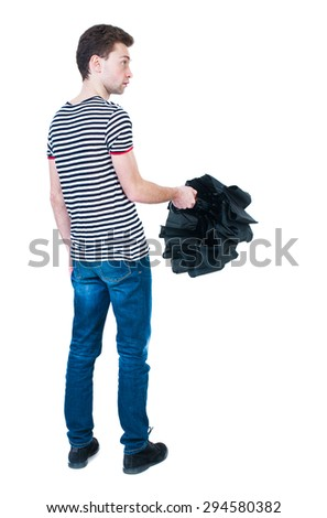 Back view of man in jeans  with umbrella. Standing young guy. Rear view people collection.  backside view of person.  Isolated over white background. The guy in the striped shirt covers the umbrella - stock photo