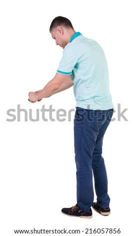 Back view of man photographing. tourist with camera. Rear view people collection.  backside view of person.  Isolated over white background. - stock photo