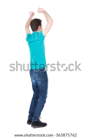 Back view of  man.  Raised his fist up in victory sign.   Rear view people collection.  backside view of person.  Isolated over white background. Guy happily he raised both arms above his head. - stock photo