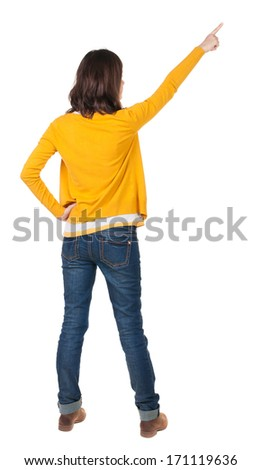 Back view of  pointing woman. beautiful brunette  girl in yellow pullover. Rear view people collection.  backside view of person.  Isolated over white background. - stock photo