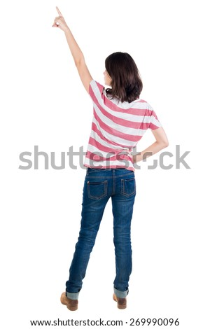 Back view of  pointing woman. beautiful brunette  girl in yellow striped t-shirt. Rear view people collection.  backside view of person.  Isolated over white background. - stock photo