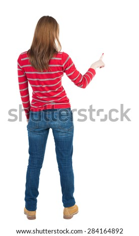 Back view of  pointing woman. beautiful girl. Rear view people collection.  backside view of person.  Isolated over white background. The blonde in a red striped sweater right thumb presses the button - stock photo