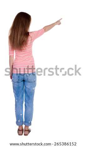 Back view of  pointing woman. beautiful redhaired  girl . girl shows something to someone. Rear view people collection.  backside view of person.  Isolated over white background.  - stock photo