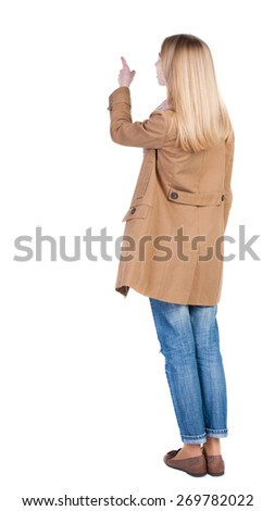 Back view of  pointing womanin brown cloak. beautiful brunette  girl. Rear view people collection.  backside view of person.  Isolated over white background. - stock photo