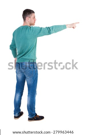 Back view of  pointing young men in jeans. Young guy  gesture. Rear view people collection.  Isolated over white background. The guy in the green jacket stands sideways and shows a finger right - stock photo
