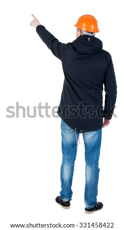 Back view of  pointing young men in parka and helmet. Young guy  gesture. Rear view people collection.  backside view person.  Isolated over white background. Young engineer supervises construction.  - stock photo
