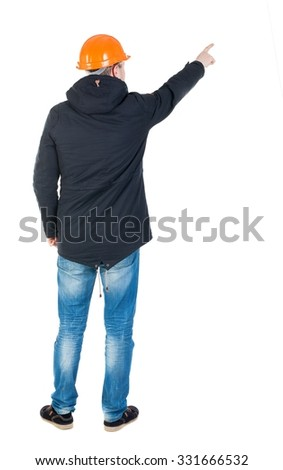 Back view of  pointing young men in parka and helmet. Young guy  gesture. Rear view people collection.  backside view person.  Isolated over white background. Young engineer specifies the left hand  - stock photo