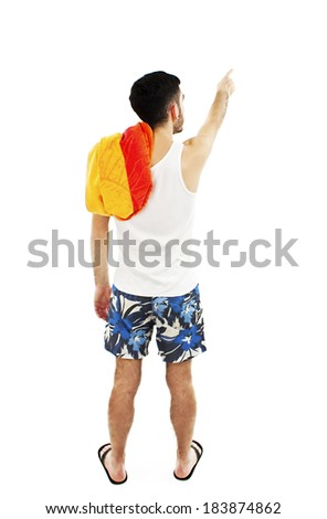 Back view of pointing young men in shorts with towel. Rear view people collection. Isolated on white background  - stock photo