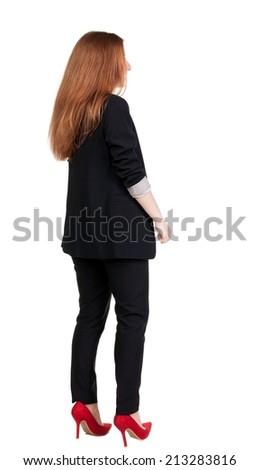 back view of redhead business woman contemplating. Young girl in suit.  Rear view people collection.  backside view of person.  Isolated over white background.